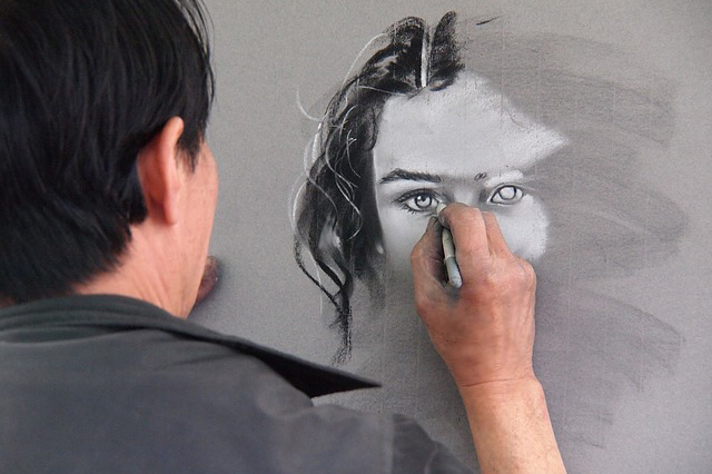 older man drawing a woman's face