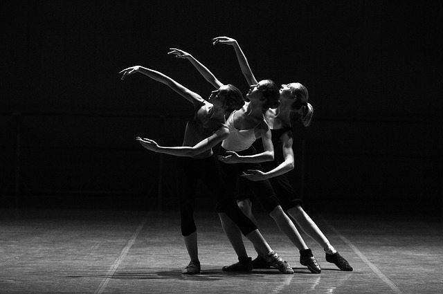 black and white image of three women doing ballet routine